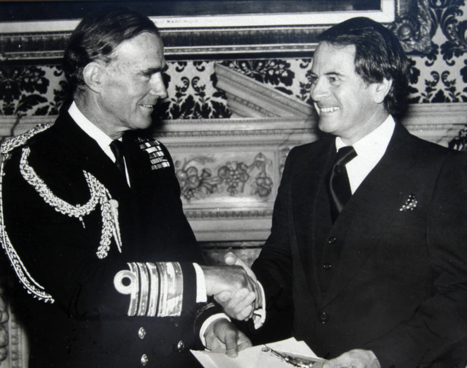 Admiral Tait, Second Sea Lord, receiving a check for the Sailor's Fund from Pusser's founder